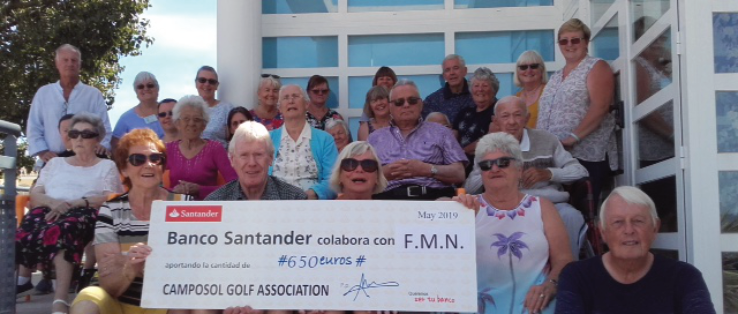 Presentation of cheque from Betty and Lloyd Roberts of the Camposol Golf Association'