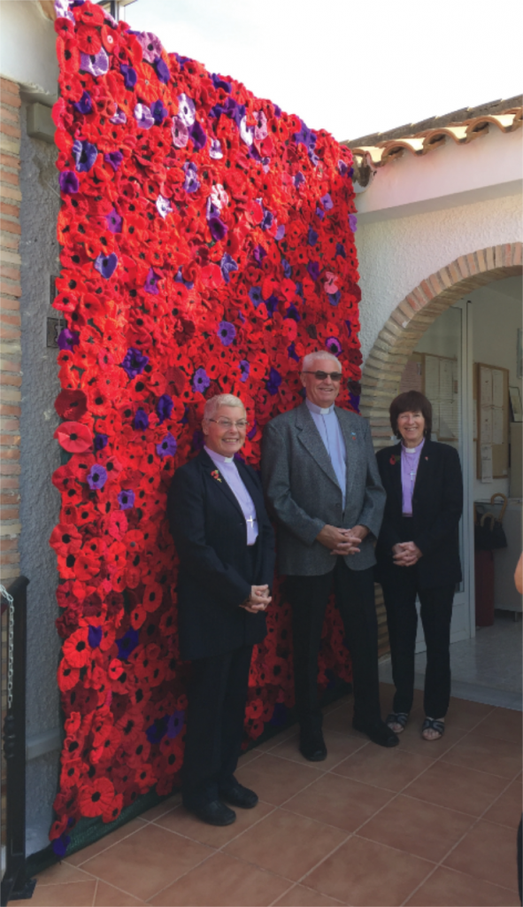 The beautiful display of Red and purple poppies out side the church