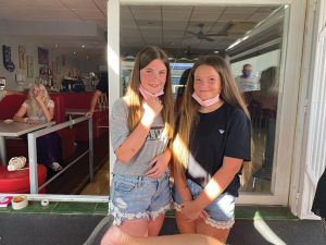 Devon and Holly who went round and collected money from all bars by telling people to come and watch their dad get waxed!