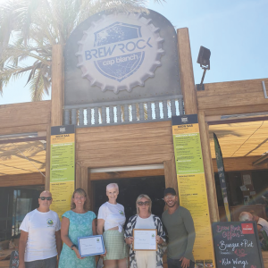 Money being handed over by Jane Martin, Lisa Griffin and Mario Mota-Reed to the Samaritans President, Donna Williams and VP, Les Holloway.  Thank you to Charlie Brown and all at Brew Rock in Albir.