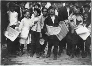 Newsboys & a girl in the USA c.1900 (Photo by Lewis Hine)